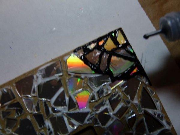 Майстер клас виготовлення фоторамки з старих дисків своїми руками.