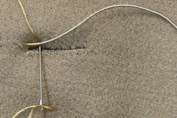Як зробити прорізну петлю для одягу.