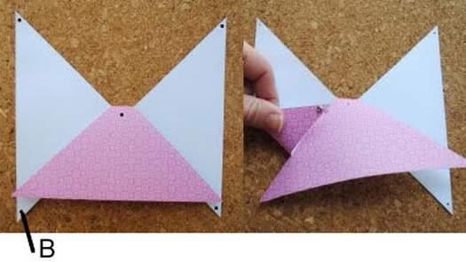 Як зробити паперовий декоративний бантик для прикраси подарунка