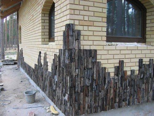 Облицювання фасаду будинку штучним каменем своїми руками не складе праці